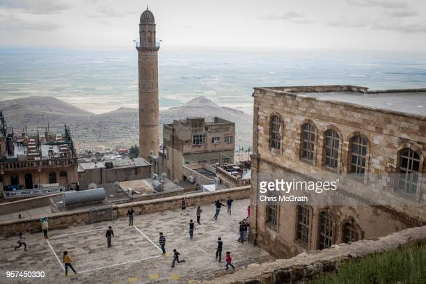 Children play at a school in the Old City of Mardin on May 11 2018 in Mardin Turkey Mardin a historical city in South Eastern Turkey is situated on...