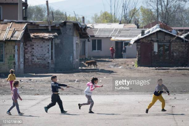 Children play at game pretending they are driving a horse cart in Fakulteta the biggest Roma neighborhood in the capital Sofia Health workers set up...