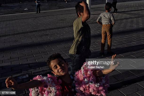 Children play at Istanbul's central Taksim Square on July 19 2016 in Istanbul Turkey Clean up operations are continuing in the aftermath of Friday's...
