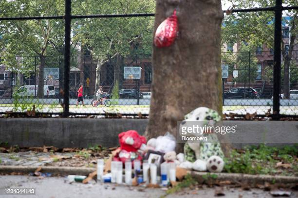 Children play at Raymond Bush Playground behind the memorial for Davell Gardner Jr., a 1-year-old who was killed while sitting in a stroller at a...