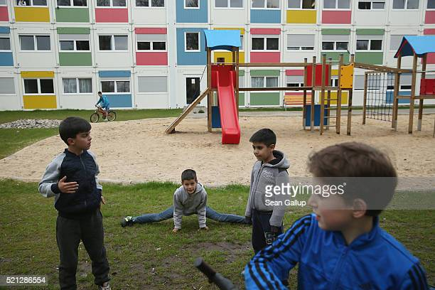 Children play at the container settlement shelter for refugees and migrants in Zehlendorf district on April 14 2016 in Berlin Germany Locals many of...