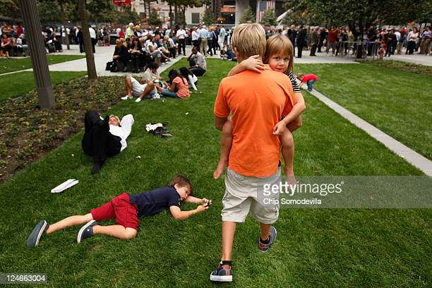 Children play at the dedication ceremony for the 9/11 Memorial during the tenth anniversary ceremonies of the September 11 2001 terrorist attacks at...