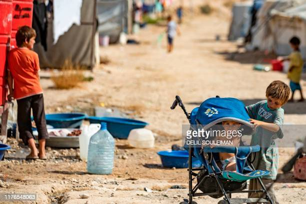 Children play at the Kurdishrun alHol camp for the displaced where families of Islamic State foreign fighters are held in the alHasakeh governorate...