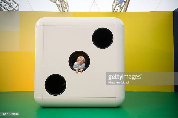 Children play at the opening of artist Carsten Holler's installation 'Gartenkinder' in which he has transformed the Gagosian Gallery's stand at...