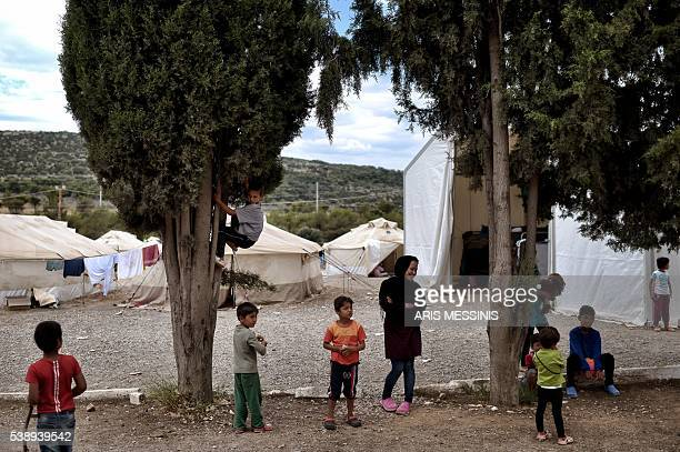 Children play at the refugee camp of Schisto on June 8 2016 in Athens The Schisto camp which accomodates some 1700 migrants of all ages the vast...