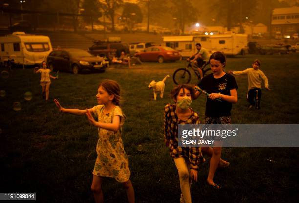 Children play at the showgrounds in the southern New South Wales town of Bega where they are camping after being evacuated from nearby sites affected...