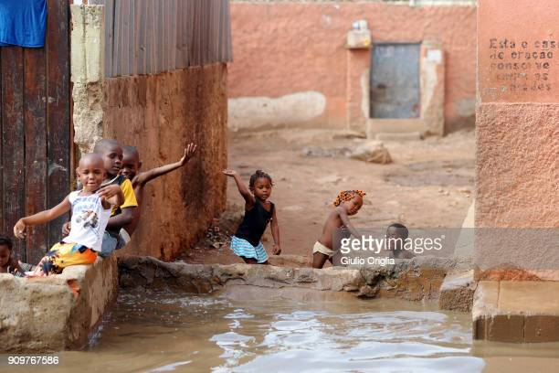 Children play at the slum of Mota flooded after heavy rain on January 24 2018 in Luanda Angola Angola has vast mineral and petroleum reserves and its...