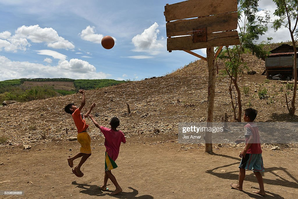 COTABATO, MINDANAO, PHILIPPINES - APRIL 10: Children play basketball amidst a dried up corn field in Kabacan on April 10, 2016 in Cotabato, Mindanao, Philippines. The heatwave brought on by the El Nino weather phenomenon has severely affected food and water supplies in many countries. Based on reports, 85 percent of the whole Philippines will experience the effects of the drought and around 12 million Filipinos who rely on agriculture will directly be affected. In southern Philippines, where farmers lacked agricultural infrastructures and farming subsidies, the population faced impending hunger during the drought and two demonstrators were left dead and dozens of people injured after police dispersed thousands of drought-hit farmers in early April.