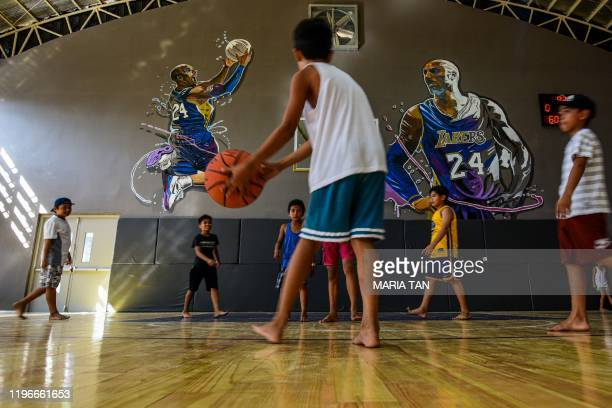Children play basketball at the House of Kobe gym built in honour of former Los Angeles Lakers basketball player Kobe Bryant's 2016 visit to the...