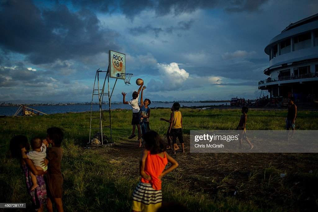 Children play basketball at the Tacloban Astrodome evacuation center following the recent super typhoon on November 20, 2013 in Leyte, Philippines. Typhoon Haiyan, which ripped through the Philippines on November 9, has been described as one of the most powerful typhoons ever to hit land, leaving thousands dead and hundreds of thousands homeless. Countries all over the world have pledged relief aid to help support those affected by the typhoon, however damage to the airport and roads have made moving the aid into the most affected areas very difficult. With dead bodies left out in the open air and very limited food, water and shelter, health concerns are growing.
