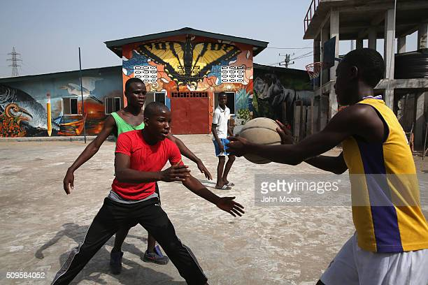 Children play basketball in front of a school formerly an Ebola center in the West Point slum on February 10 2016 in Monrovia Liberia The school was...