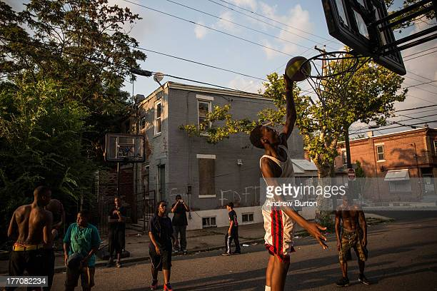 Children play basketball in the street on August 20, 2013 in the Whitman Park neighborhood of Camden, New Jersey. The town of Camden, which was once...
