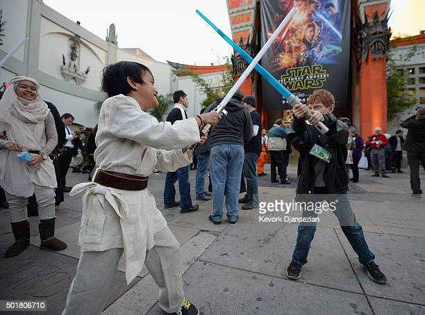 Children play before the opening night of Walt Disney Pictures and Lucasfilm's Star Wars The Force Awakens at TCL Chinese Theatre on December 17 2015...