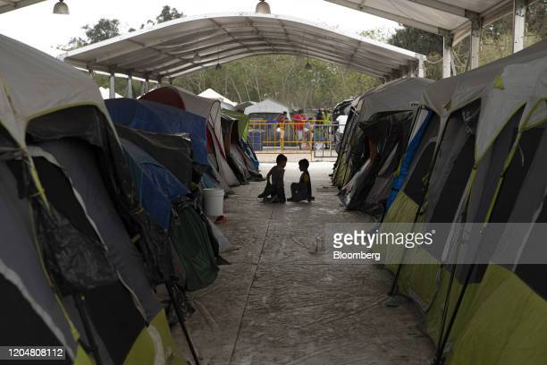 Children play between tents at a makeshift migrant camp in Matamoros, Tamaulipas state, Mexico, on Sunday, March 1, 2020. The San Francisco-based...