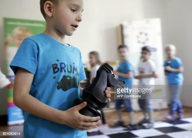 Children play chess on June 14, 2017 at the 'Brumi' preschool in Budapest, with the teaching method Judit Polgar's Chess playground. Raised in...