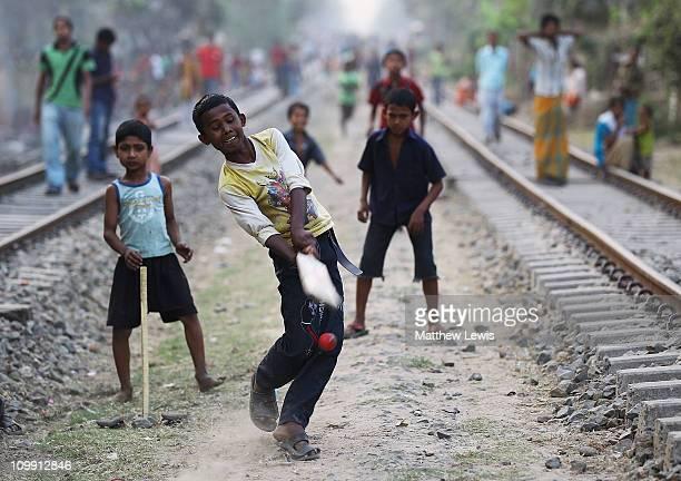 Children play cricket on railway tracks on March 10 2011 in Chittagong Bangladesh
