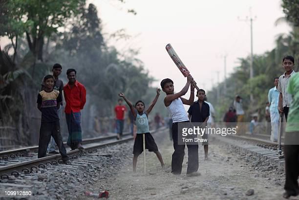 Children play cricket on the railway tracks on March 10 2011 in Chittagong Bangladesh