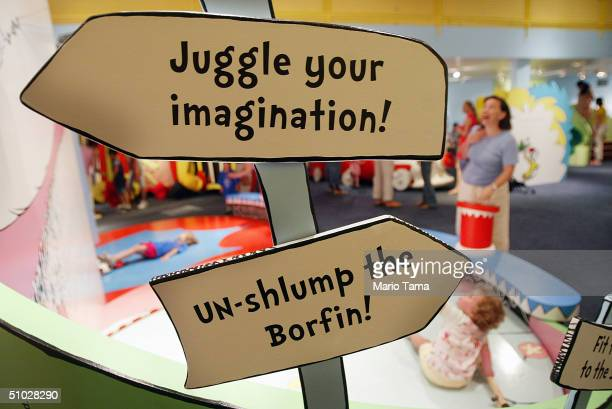 Children play during a press preview of an interactive exhibition dedicated to Dr Seuss at the Children's Museum of Manhattan July 6 2004 in New York...