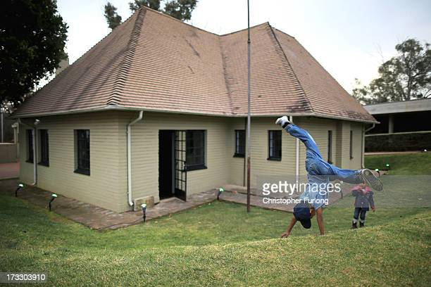 Children play during anniversary celebrations at Liliesleaf Farm the apartheidera hideout for Nelson Mandela and freedom fighters in Johannesburg on...