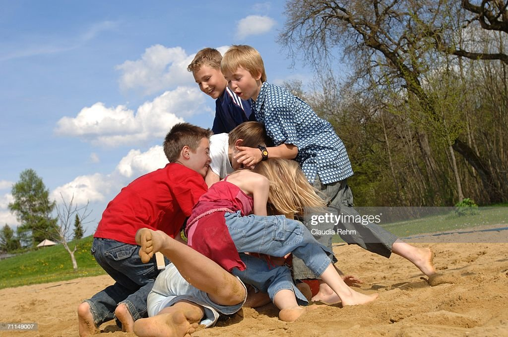 Children Play Fighting On Playground High-Res Stock Photo ...