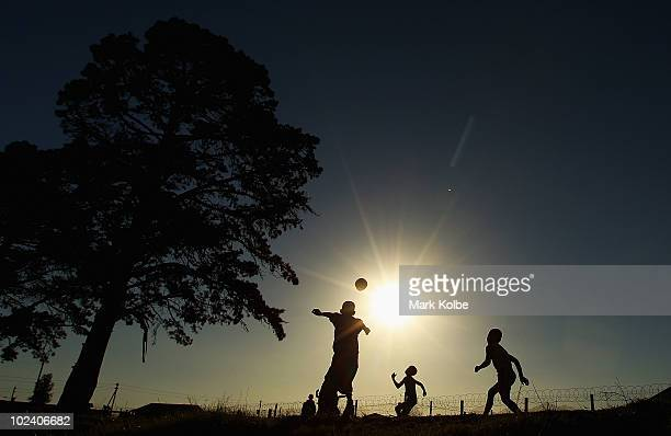 Children play football as they wait for the arrival of the Japan football team at the Lawaaikamp Sport ground for township visit during the FIFA 2010...
