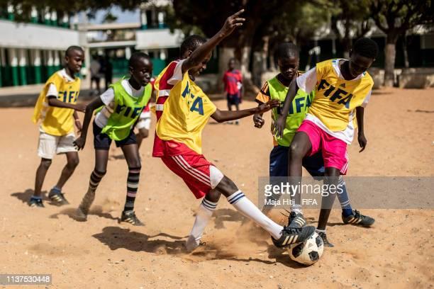 Children play football during a FIFA Grassroots schools program on January 17 2019 in Dakar Senegal