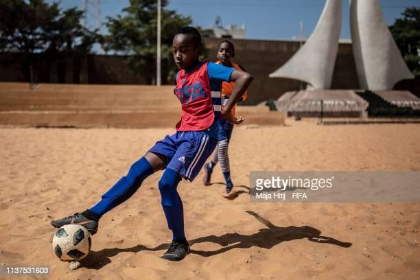 Children play football during a FIFA Grassroots schools program on January 16 2019 in Dakar Senegal