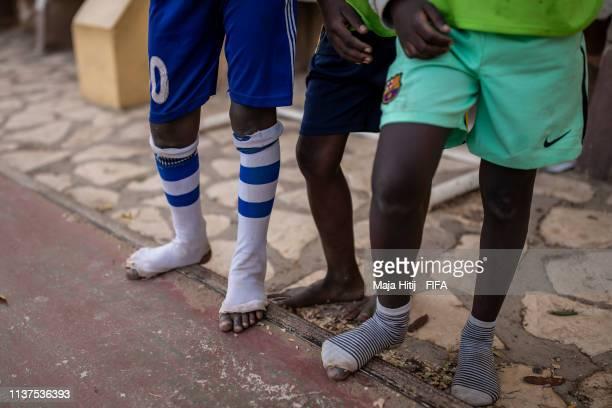 Children play football during a FIFA Grassroots schools program on January 18 2019 in Dakar Senegal