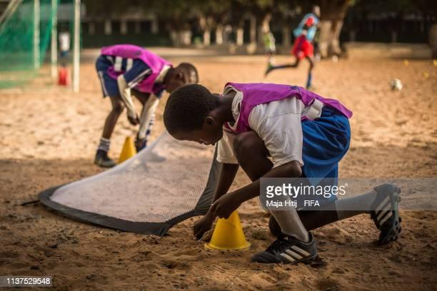 Children play football during a FIFA Grassroots schools programme on January 15 2019 in Dakar Senegal