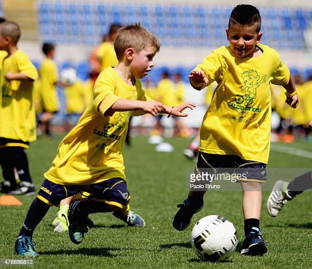 Children play football during the 'Calcio in Erba' juvenile football event at Olimpico Stadium on June 11 2015 in Rome Italy