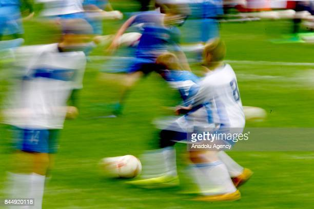 Children play football during the official kickoff ceremony for the 2018 FIFA World Cup Trophy Tour at Luzhniki Stadium in Moscow Russia on September...