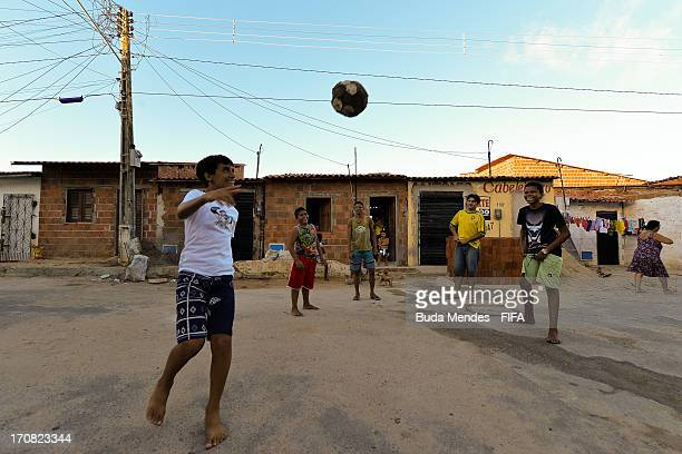 Children play football in a Favela on June 18 2013 in Fortaleza Brazil