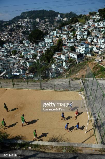Children play football in a Favela on June 8 2013 in Rio de Janeiro Brazil
