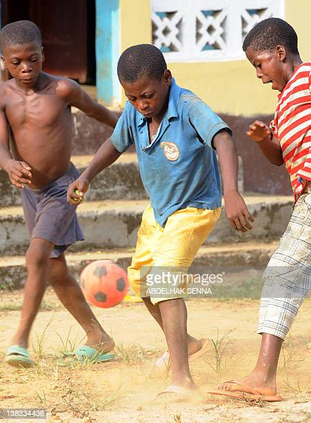 Children play football in a poor district of Bata on February 5 2012 in a street of Bata one of the four cities hosting matches of the 2012 Africa...
