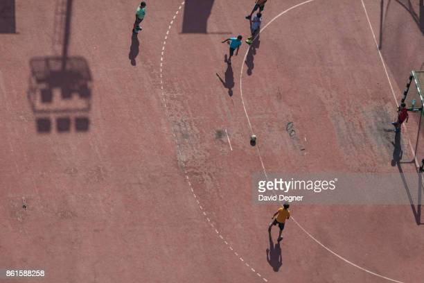 Children play football in a private club on September 24 2017 in Cairo Egypt Overview photos of Cairo's buildings cityscape and infrastructure from...