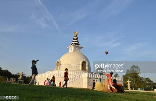 Children play football in Indraptastha park after the air quality improved in New Delhi on November 17, 2019.