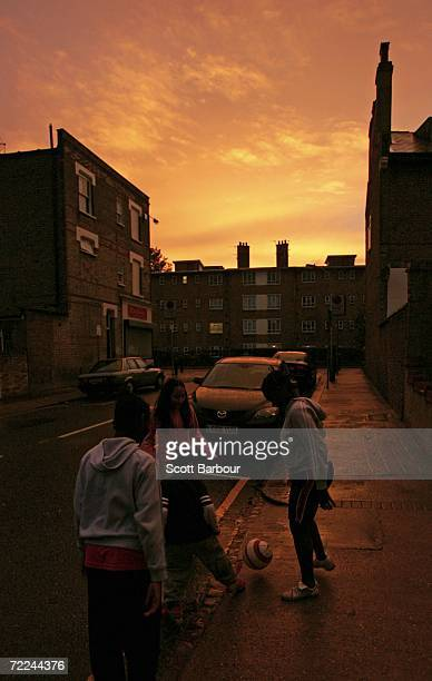 Children play football in the street as a spectacular sunset brightens up the sky on October 23 2006 in London England According to the Met Office it...