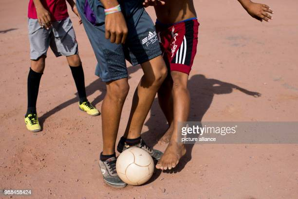 Children play football on a field directly behind the equator in Macapa Brazil 17 November 2017 Measurements show that the equator draws through the...