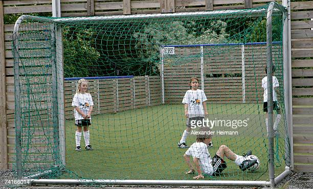 Children play football on a synthetic turf football ground of the Georg Buechner Schule on May 16 2007 in Darmstadt Germany The German Football...