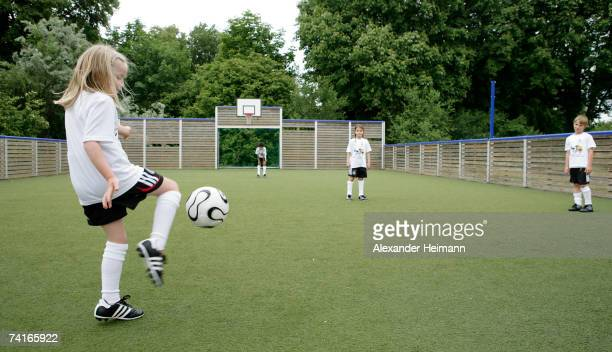 Children play football on the synthetic turf football ground of the Georg Buechner Schule on May 16 2007 in Darmstadt Germany The German Football...