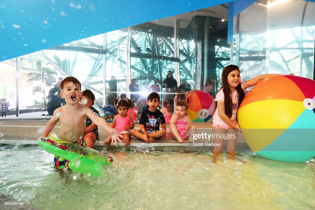 Children play in a 11 metre long swimming pool to celebrate the Australian premiere of The Pool exhibition at the National Gallery of Victoria International on August 18, 2017 in Melbourne, Australia. The exquisitely designed pool is complete with wooden decking and bespoke pool lounge chairs, with visitors invited to dangle their feet in the water and sit poolside to reflect on one of Australia's greatest cultural icons - the pool. The Pool debuted at the 2016 Venice Architecture Biennale, where it received more than 100,000 visitors.