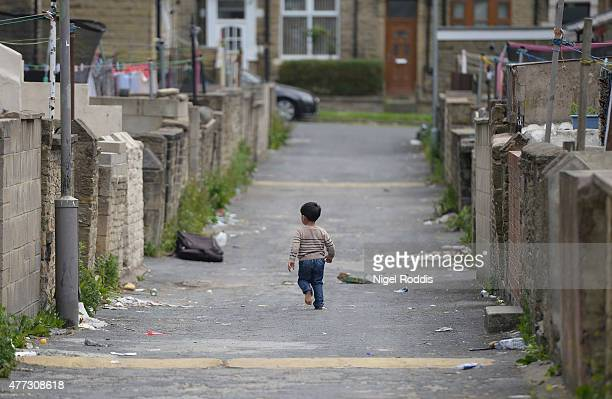 Children play in a back street on June 16 2015 in Bradford England Three sisters from Bradford are feared to have travelled to Syria with their nine...