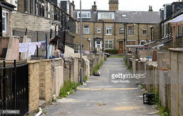Children play in a back street on June 16, 2015 in Bradford, England. Three sisters from Bradford are feared to have travelled to Syria with their...