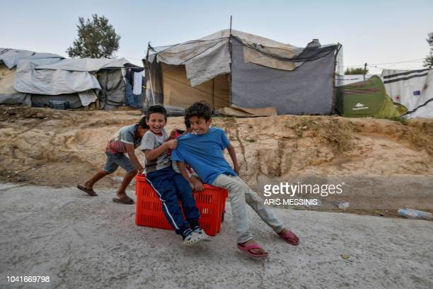 Children play in a camp outside the refugee camp of Moria in the northern Greek island of Lesbos on September 25 2018 Despite a 2016 agreement...