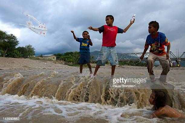 Children play in a dirty river April 21 2012 in Dili East Timor Millions have been spent on aid during the first 10 years as the country moves...