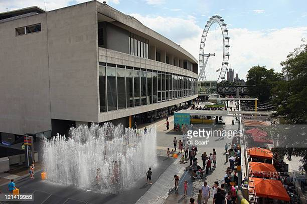 Children play in a fountain entitled 'Appearing Rooms' by artist Jeppe Hein at the Southbank Centre on August 19 2011 in London England Members of...