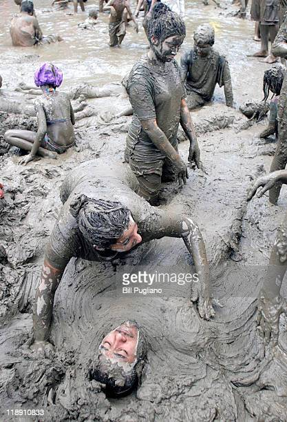 Children play in a giant lake of mud during Wayne County's 2011 Mud Day event at Nankin Mills July 12 2011 in Westland Michigan The annual event...