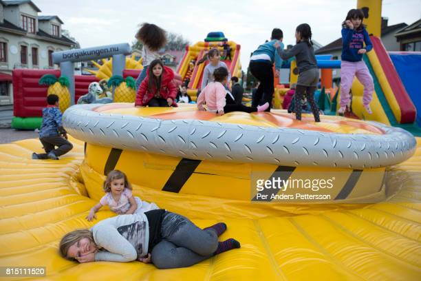Children play in a jumping castle on May 5 2017 in Svenljunga Sweden Sweden has seen a large influx of refugees the last few years mainly from Africa...