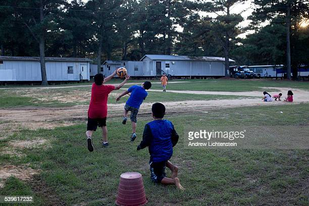 Children play in a migrant labor camp in rural North Carolina Most of the children attend local schools and speak fluent english The agricultural...