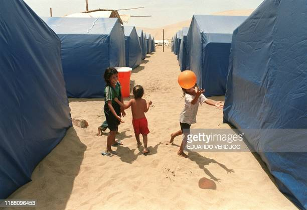 Children play in a passage amid numerous tents 26 February installed in the middle of a desert for the civil defense of as many as 1200 people...